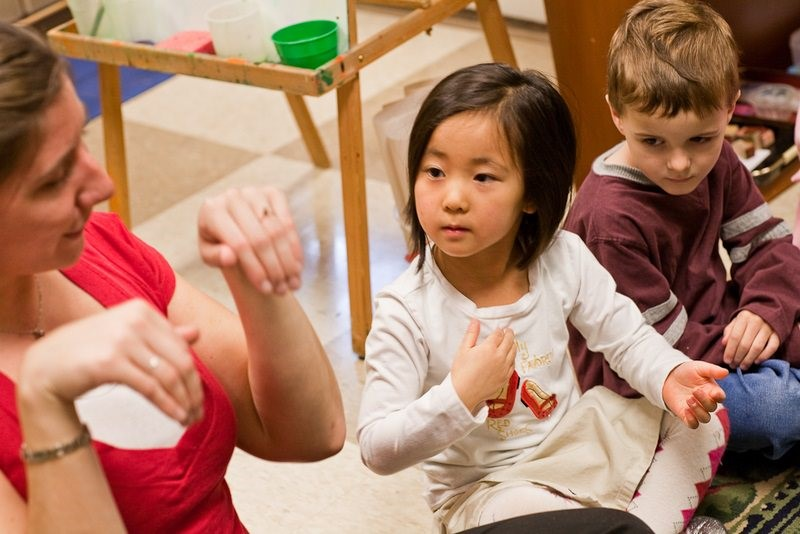 teacher moving hands and 2 students